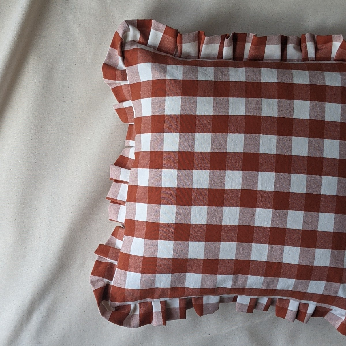 Cutting Floor Cushions terracotta gingham cushion detail homewares at Sustainable Dept. Store
